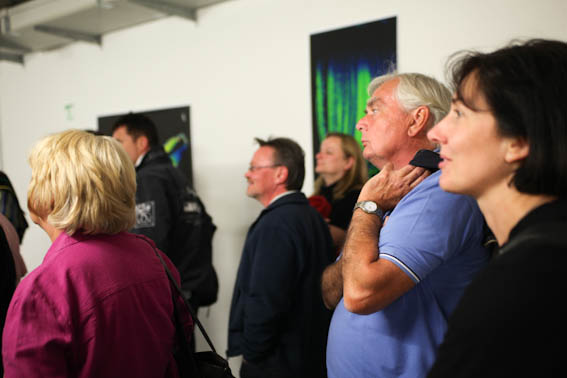 Visitors watching MRI gallery on the corridor